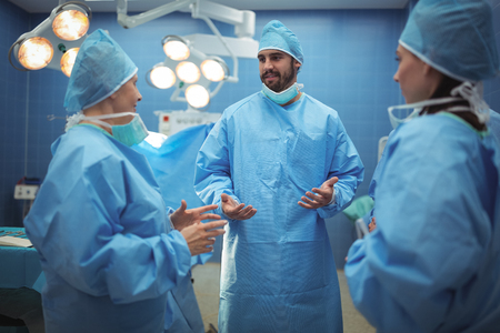 operative: Team of surgeons having discussion in operation theater at hospital