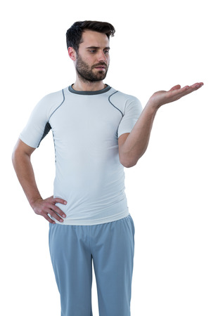 invisible object: Man pretending to hold an invisible object against white background