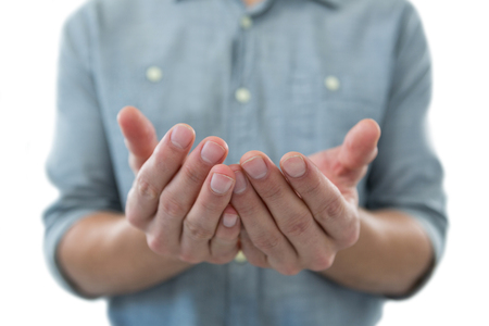 invisible object: Cupped hands of man pretending to hold an invisible object against white background