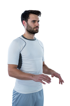 Man pretending to touch an invisible object against white background