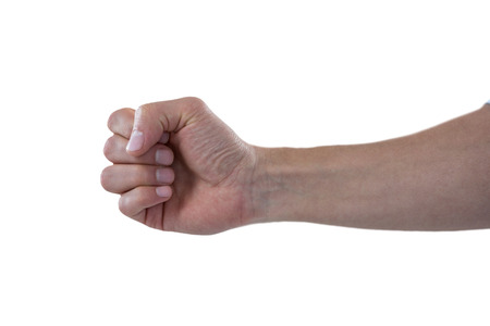 tight focus: Close-up of clenched fist of a man against white background