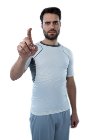 invisible: Man pretending to touch an invisible screen against white background