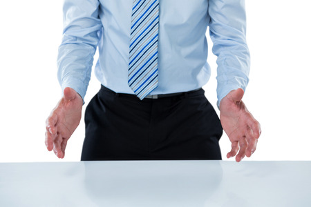 invisible object: Mid section of businessman pretending to hold an invisible object Stock Photo