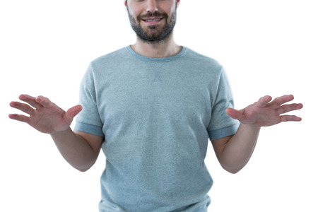invisible object: Man pretending to touch an invisible object against white background
