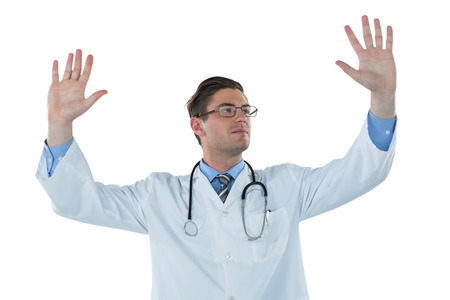 gesturing: Male doctor gesturing against white background Stock Photo