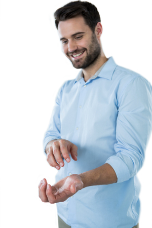 invisible object: Smiling man pretending to hold an invisible object