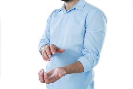 invisible object: Mid section of man pretending to hold an invisible object