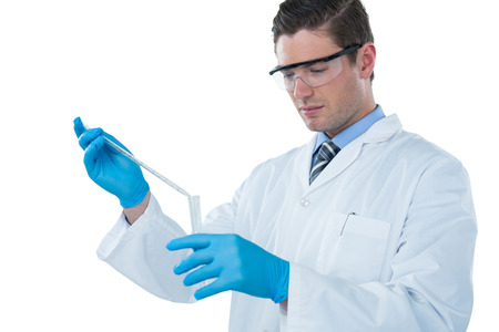 Doctor wearing medical gloves filling the test tube against white background