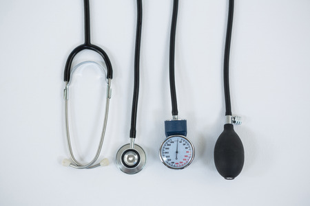 tonometer: Blood pressure measuring equipment and stethoscope on white background Stock Photo