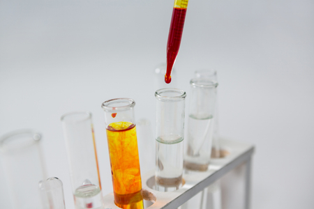 test tube holder: Close-up of blood sample being drop into test tubes