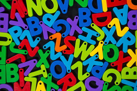 jumbled: Close-up of multicolored jumbled alphabets
