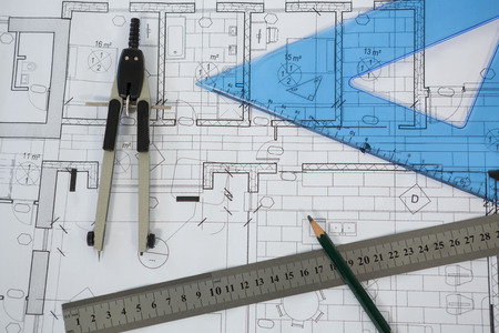 autocad: Close-up of blueprint with ruler, pencil and thumbscrew compasses