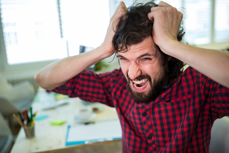 uneasy: Frustrated business executive at desk in office