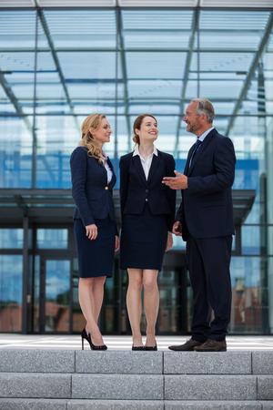 premises: Happy businesspeople having a conversation in office premises