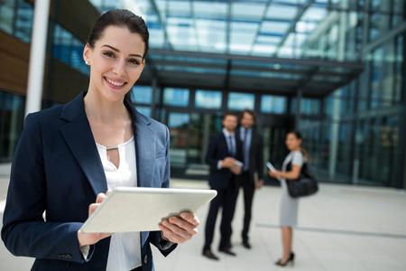 premises: Portrait of a businesswoman holding digital tablet in office premises