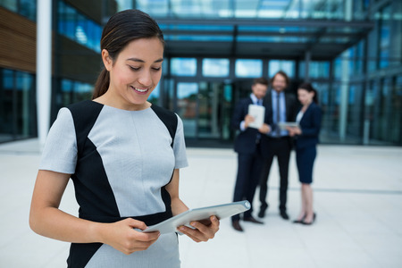 premises: Businesswoman holding digital tablet in office premises Stock Photo