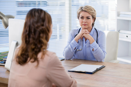 hospital stretcher: Patient consulting a doctor at the hospital Stock Photo