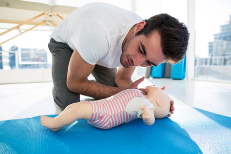 Paramedic practicing resuscitation on dummy in clinic Stock Photo