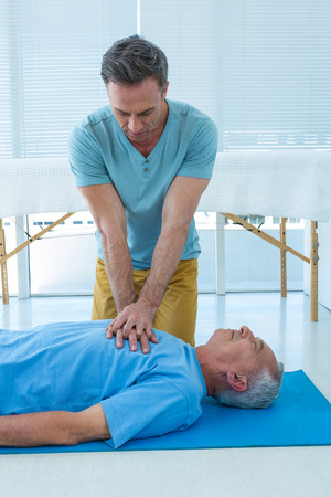 Paramedic performing resuscitation on patient in clinic Stock Photo