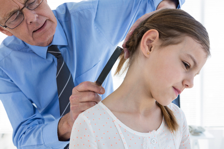 endocrinology: Doctor examining patient neck in clinic