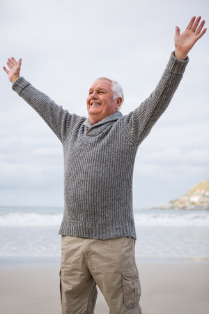 arms wide open: Happy senior man with arms wide open at the beach