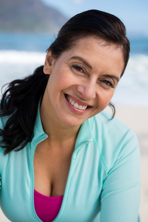 Portrait of smiling woman at the beach