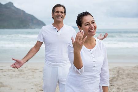 Romantic couple enjoying on beach during winter