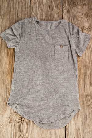 wood panelling: Grey pocket t-shirt on wood panelling