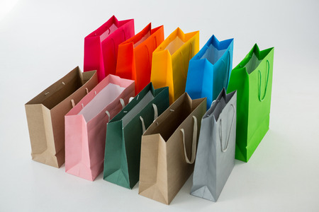 overspending: Colorful shopping bags against white background Stock Photo