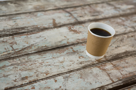 disposable cup: Coffee in disposable cup on wooden table Stock Photo