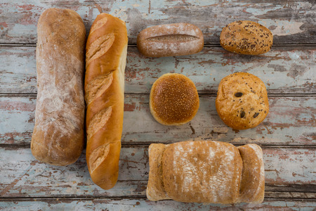 Close-up of different types of bread on wooden surface