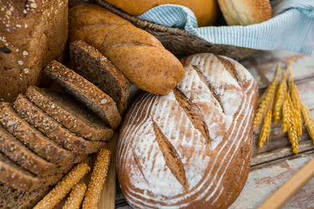 loaves: Close-up of bread loaves on wooden background