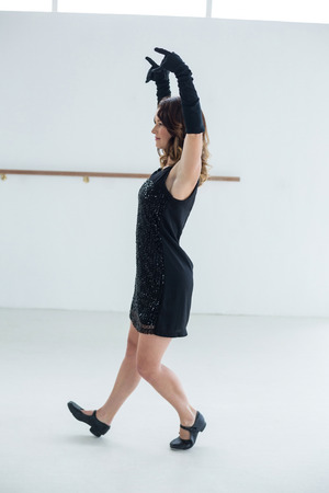 harming: Dancer practicing contemporary dance in dance studio Stock Photo