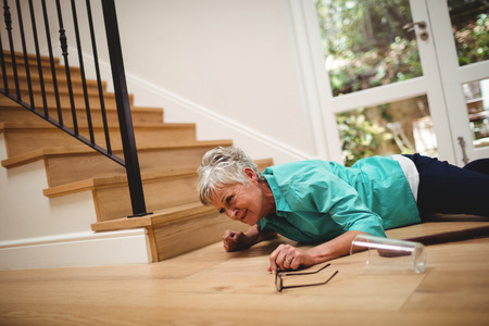 Senior woman fallen down from stairs at home Stock Photo - 69603925
