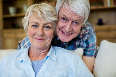 ageing process: Portrait of senior couple embracing each other at home