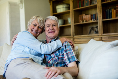 ageing process: Senior couple relaxing on sofa in living room at home Stock Photo