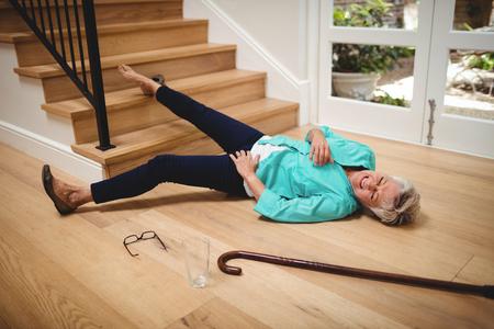 年配の女性自宅の階段から落ちた 写真素材