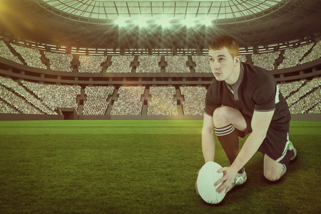 kick around: Rugby player ready to make a drop kick against rugby stadium with copy space 3d