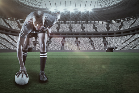 kick around: Portrait of rugby player smiling against rugby stadium with copy space 3d