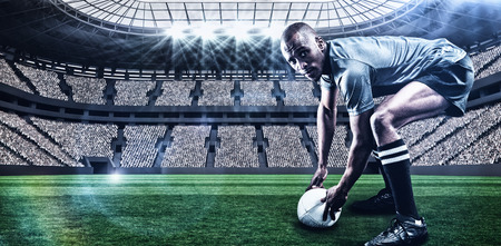 kick around: Portrait of rugby player holding ball against rugby stadium with copy space 3d