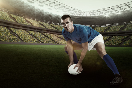 kick around: Confident rugby player playing against rugby stadium with copy space 3d