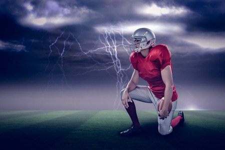 paraplegico: American football player looking away while kneeling against stormy dark sky with lightning bolts with copy space 3d