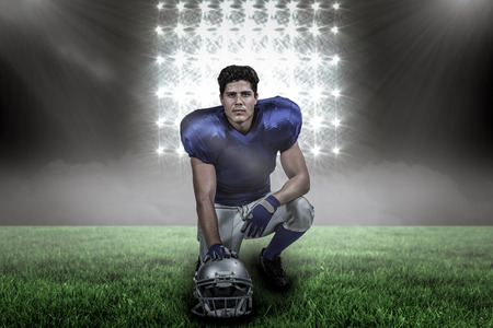Portrait of confident American football player with hand on helmet against spotlight with copy space 3d