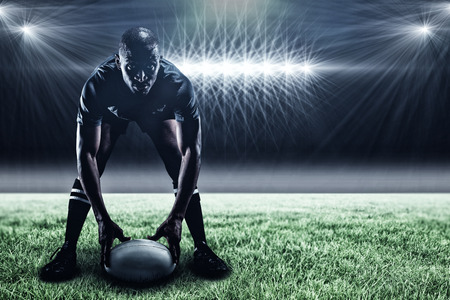kick around: Sportsman holding ball while playing rugby against spotlight and copy space 3d Stock Photo