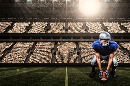 paraplegico: Portrait of American football player placing ball against football stadium with fans in white with copy space 3d