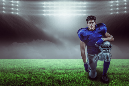 Portrait of serious sportsman holding helmet against spotlight with copy space 3d Stock Photo
