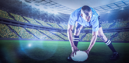 kick around: Rugby player holding ball while playing against rugby stadium with copy space 3d