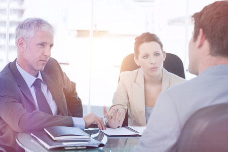 negotiating: Business team negotiating with a customer in a meeting room