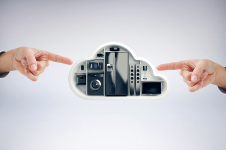 fishtank: Hand pointing against black electrical appliance in cloud shape