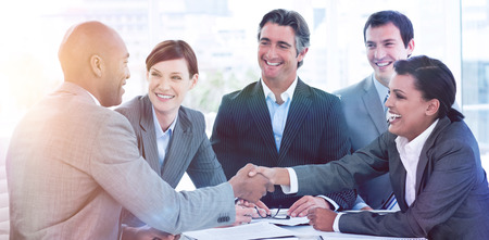 Business people greeting each other in a meeting photo
